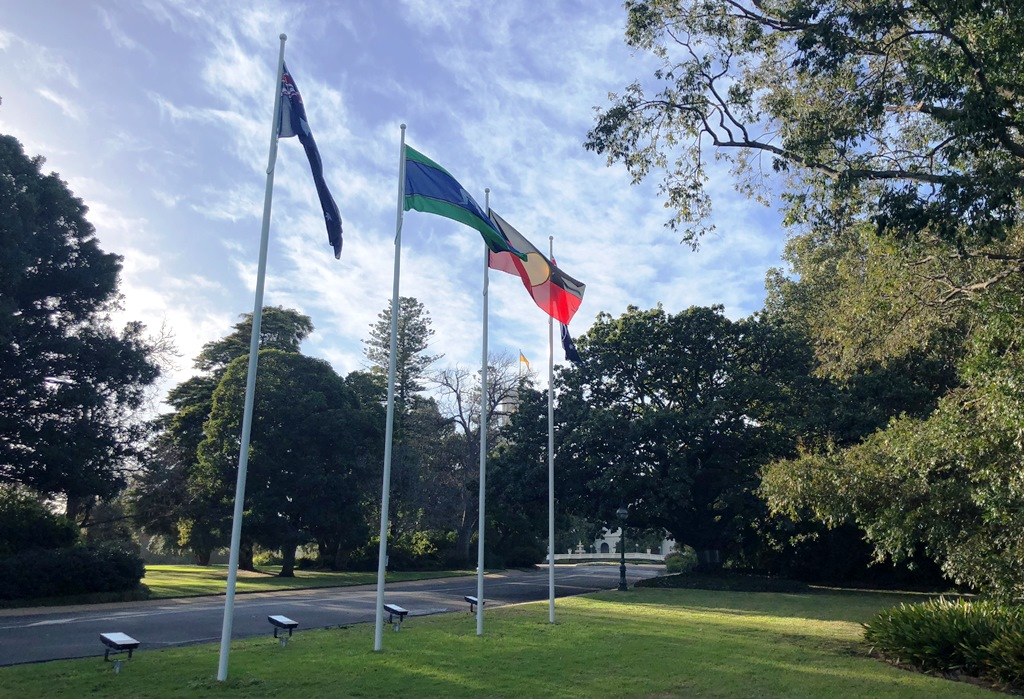 Aboriginal and Torres Strait Islander Flags fly alongside the Australian Flag at Government House