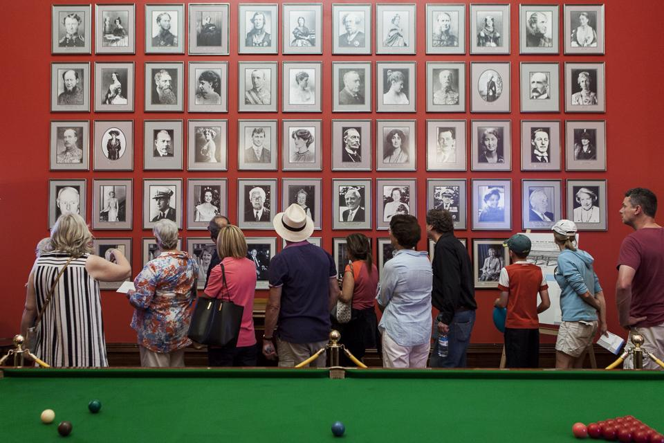 visitors in the billiard room during an open house