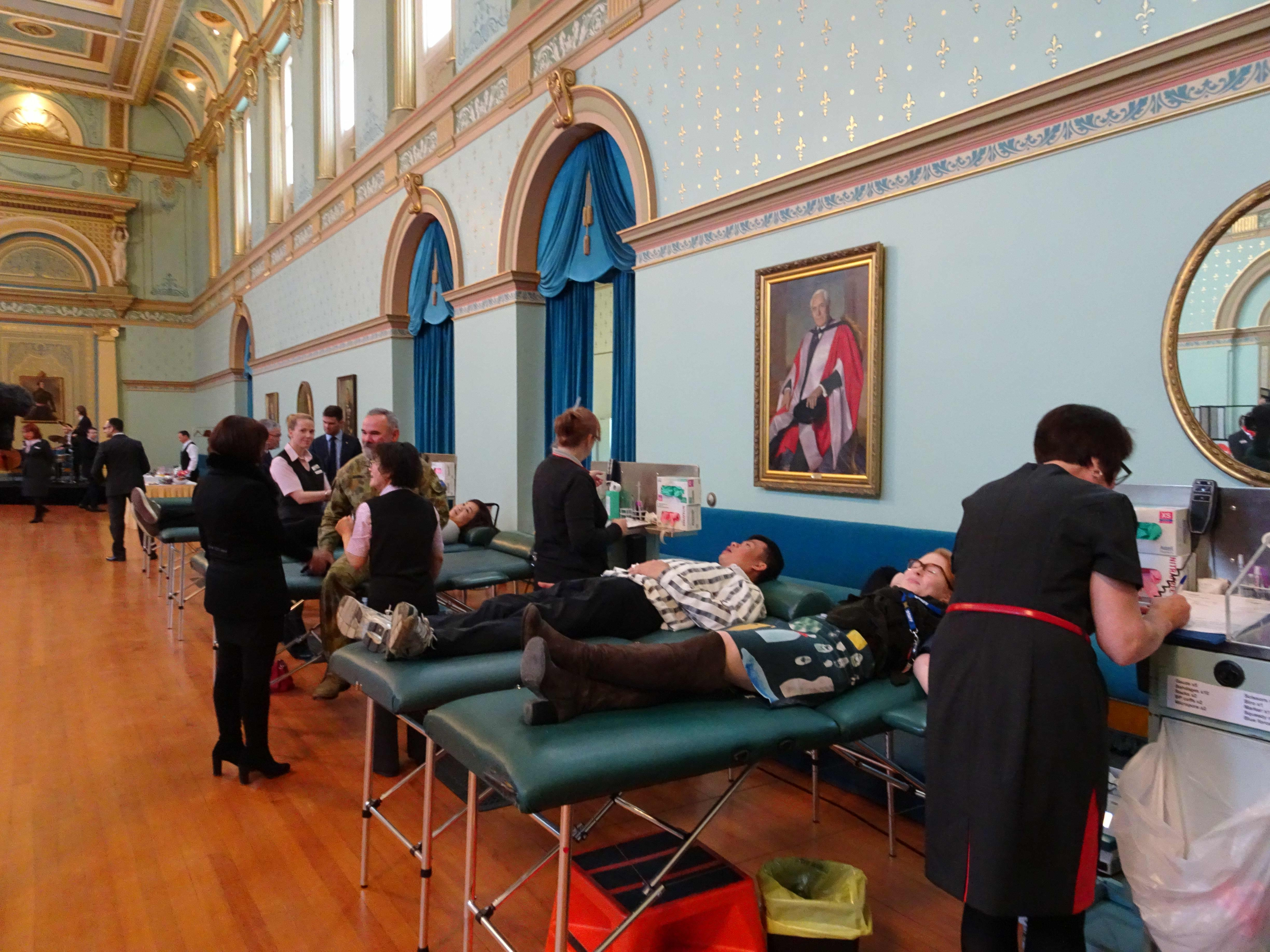 Donors giving blood in the Ballroom