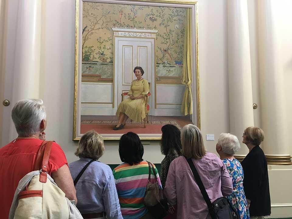 visitors viewing painting of Queen Elizabeth II at Government House
