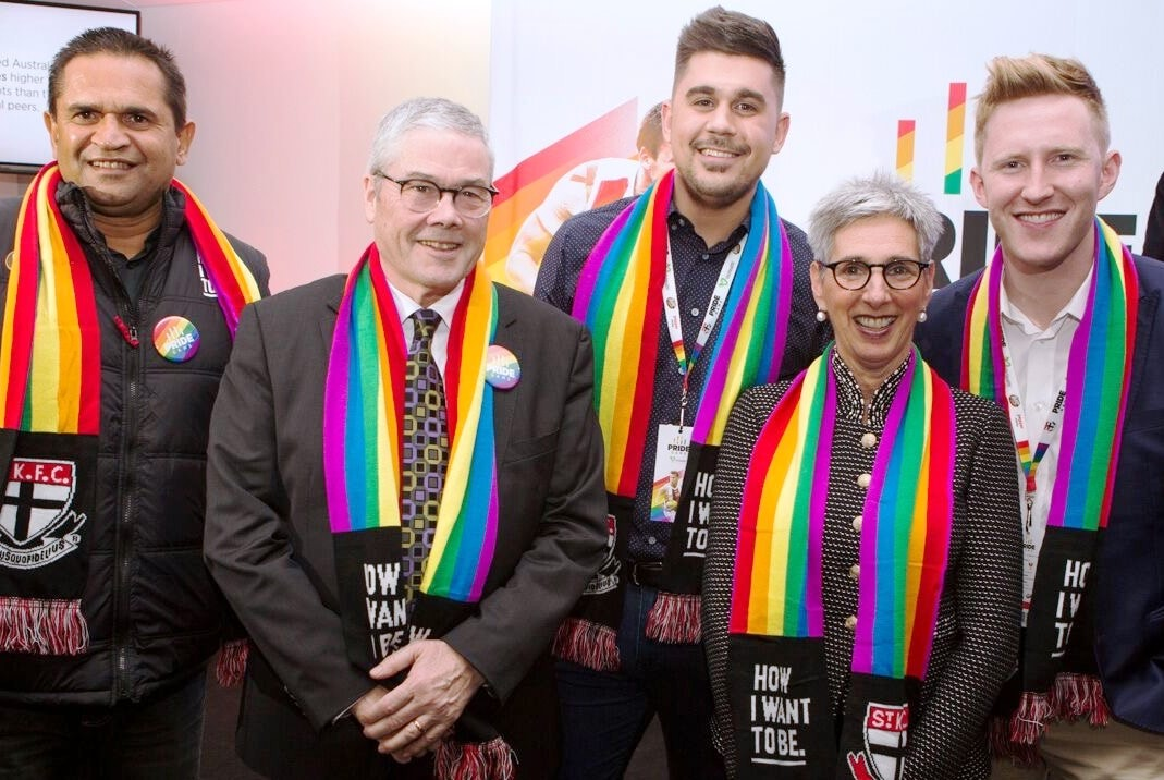The Governor and Mr Howard attending an AFL Pride Game
